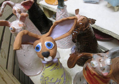 Kids Handbuilding Rabbit In Raincoat Project
